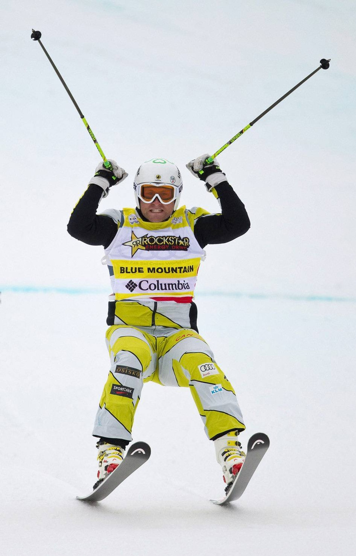 Brady Leman of Canada celebrates his win at the FIS Ski Cross World Cup race at Blue Mountain in Collingwood, Ontario February 3, 2012.