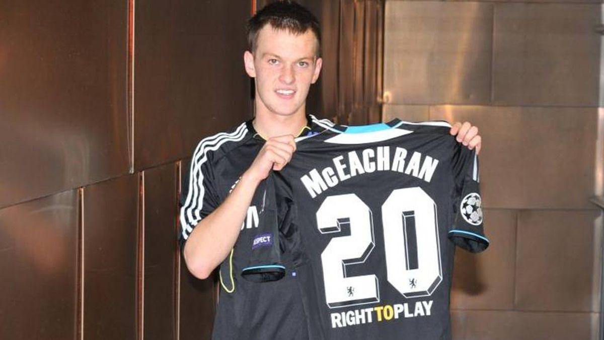 Chelsea midfielder Josh McEachran with the jersey he will wear in Champions League play on Tuesday.
