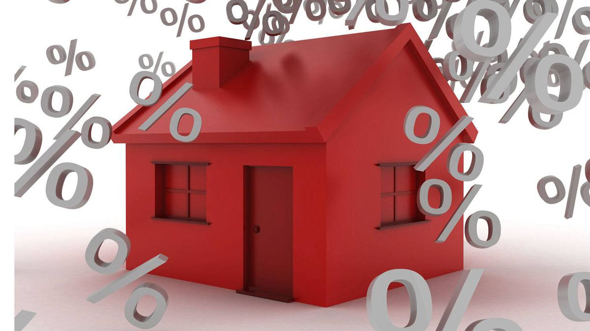 Interest rates falling on a house.
