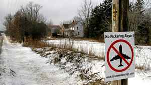 A sign against the construction of the Pickering Airport can be seen on a rural road in the town of Brougham.