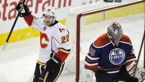 Calgary Flames' Lee Stempniak (L) celebrates a goal by teammate Blake Comeau (not pictured) against Edmonton Oilers' goalie Nikolai Khabibulin (R) during the first period of their NHL hockey game in Edmonton January 21, 2012.
