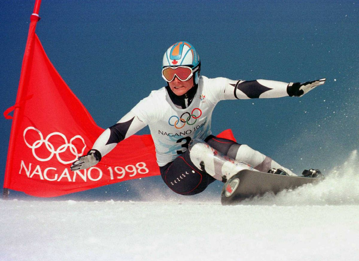 Ross Rebagliati turns on a gate while on his way to winning the gold medal in men's giant slalom snowboarding on February 8, 1998, at the Winter Games in Nagano, Japan.