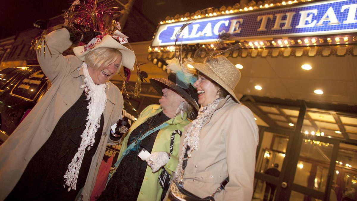 Mary Massel, left, Terry Chapman and Sally Massel gather to watch the wedding of Britain's Prince William and Catherine Middleton on a big screen at the Palace Theatre in Ontario on April 29, 2011.