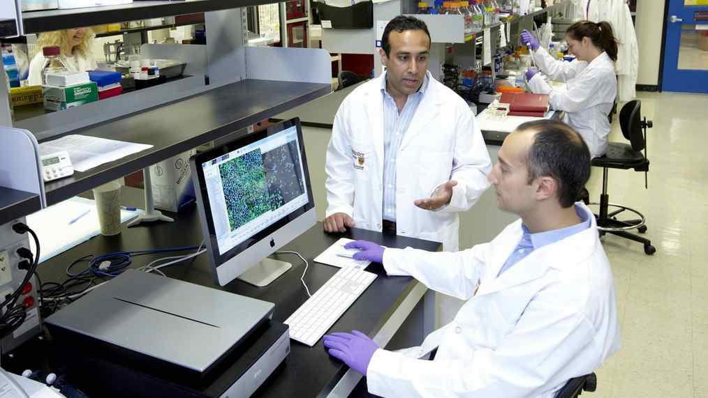 Mick Bhatia, standing, senior author of the paper and director of the McMaster Stem Cell and Cancer Research Institute in Hamilton, and Terry Sachlos, postdoctoral fellow and lead author of the paper.