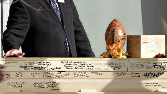 A football sits on the signed casket of Walter Borden-Wilkins during his funeral in Grand Prairie, Alberta on Thursday Oct. 27, 2011. Borden-Wilkins, 15, was killed in a car accident along with Matt Deller, 16, Tanner Hildebrand, 15 and Vincent Stover, 16, in Grand Prairie on Saturday.