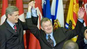 Prime Minister Stephen Harper introduces elected Senator Bert Brown to his caucus in Ottawa on Oct. 17, 2007.