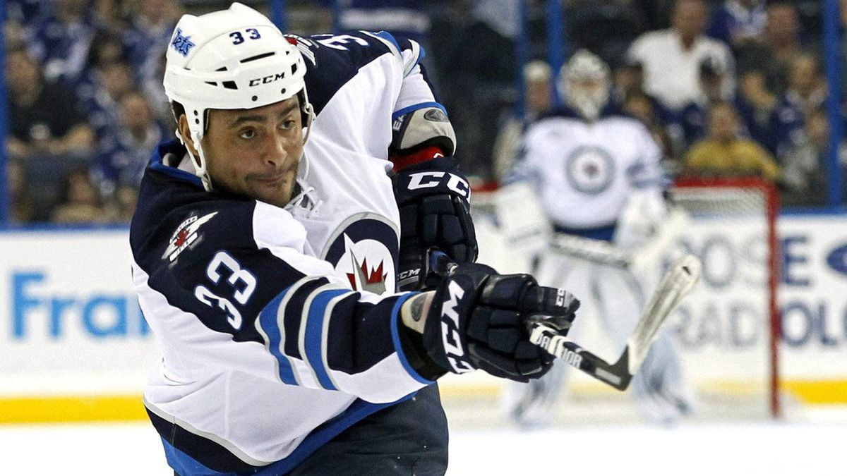 Winnipeg Jets' Dustin Byfuglien follows through on a shot during the first period of an NHL hockey game against the Tampa Bay Lightning on Thursday, Feb. 2, 2012, in Tampa, Fla.