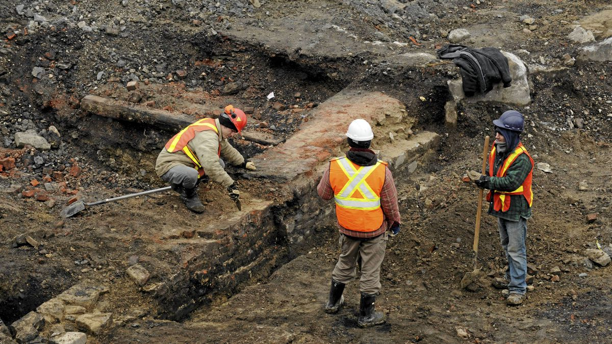 Photographs of an archaeological site south of Front St. West and immediately east of Bathurst St. on April 18 2011. Developers of a condominium and public library near Fort York have discovered the archaeological remains of an engine storage and maintenance complex built by the Grand Trunk railway in the 1850s.