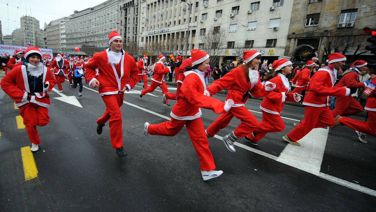 People dressd as Santa Claus take part in the traditional Christmas race in downtown Belgrade on December 25, 2011.