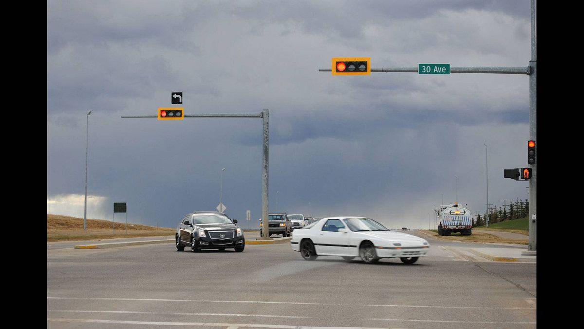 Barbara Wackerle Baker photo: Street Scenes - May 3/2011 - driving into spring storm on Red Deer, Alberta streets.