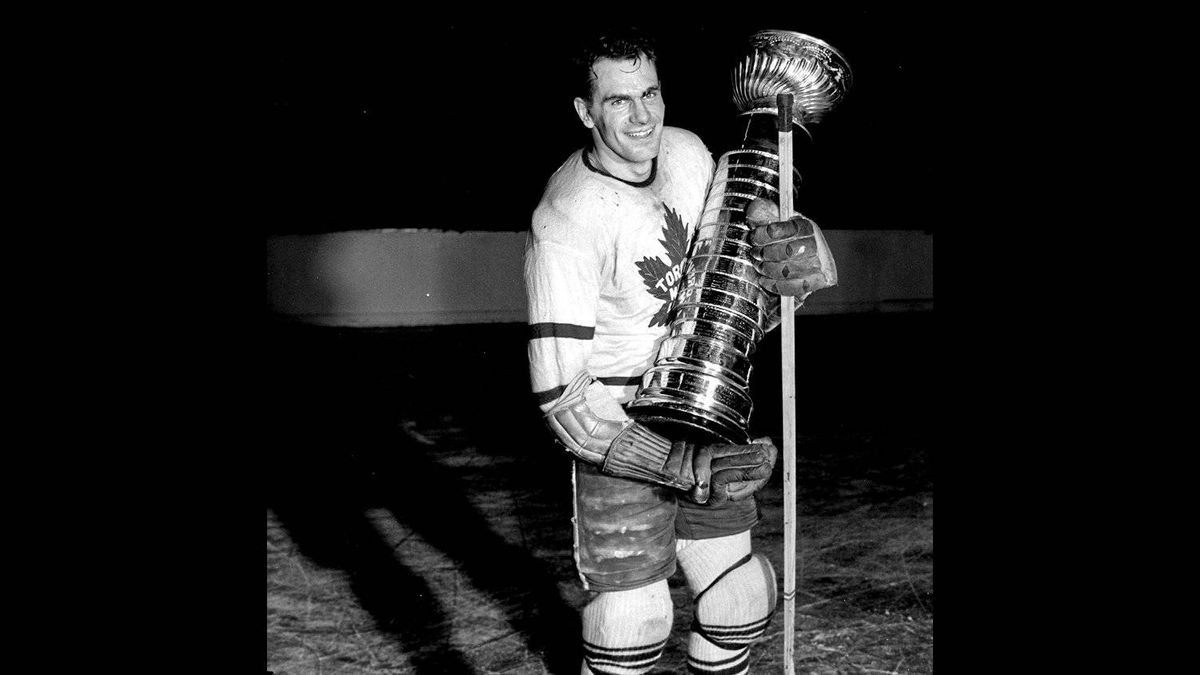 "April 18, 1942. The Stanley Cup, emblematic of hockey's world championship eluded the Toronto Maple Leafs for ten long, lean years until Saturday night when Leafs eked out a 3-1 win over Detroit Red Wings. Here we see Captain Syl Apps firmly clutching the silverware. ""It was a long wait, but it was worth it,"" said the Pride of Paris, Ont."