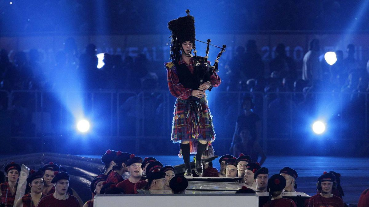 A lone piper performs at the flag handover ceremony during the closing ceremony of the Commonwealth Games at the Jawaharlal Nehru Stadium in New Delhi, India, Thursday. The Commonwealth Games 2014 will be held in Glasgow.