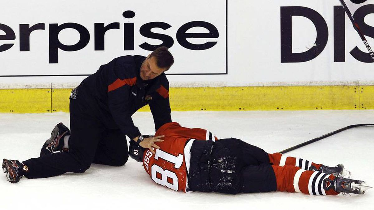 Chicago Blackhawks' Marian Hossa lies on the ice after being injured following a check by Phoenix Coyotes' Raffi Torres during Game 3 of their NHL Western Conference quarter-final playoff hockey game in Chicago.