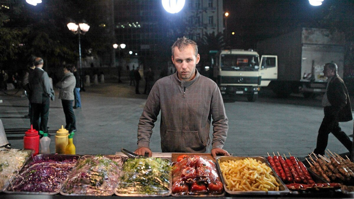 Michael Voliotis, 22, a food vendor in downtown Athens, lives with his parents. His father, a school cook, has seen his salary cut from 1200 to 900 Euros per month as part of the government's new austerity regime -- but he still enjoys three months of paid vacation per year, part of an extensive system of perks for public employees.