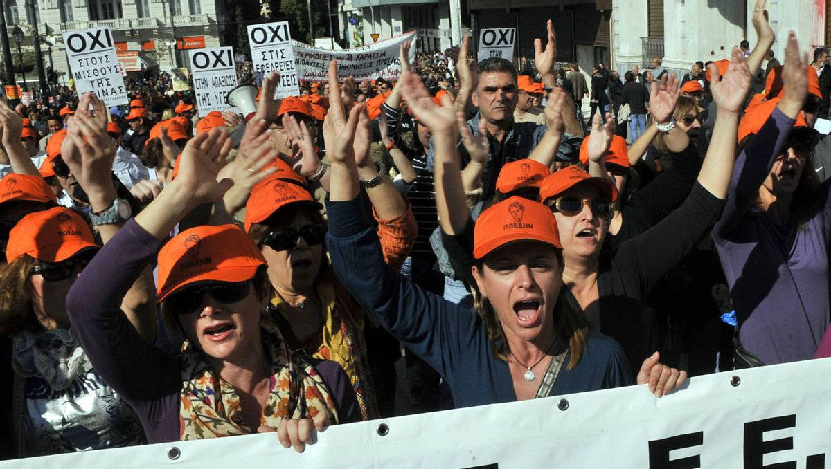 People chant slogans during a demonstration in Athens on October 20, 2011.