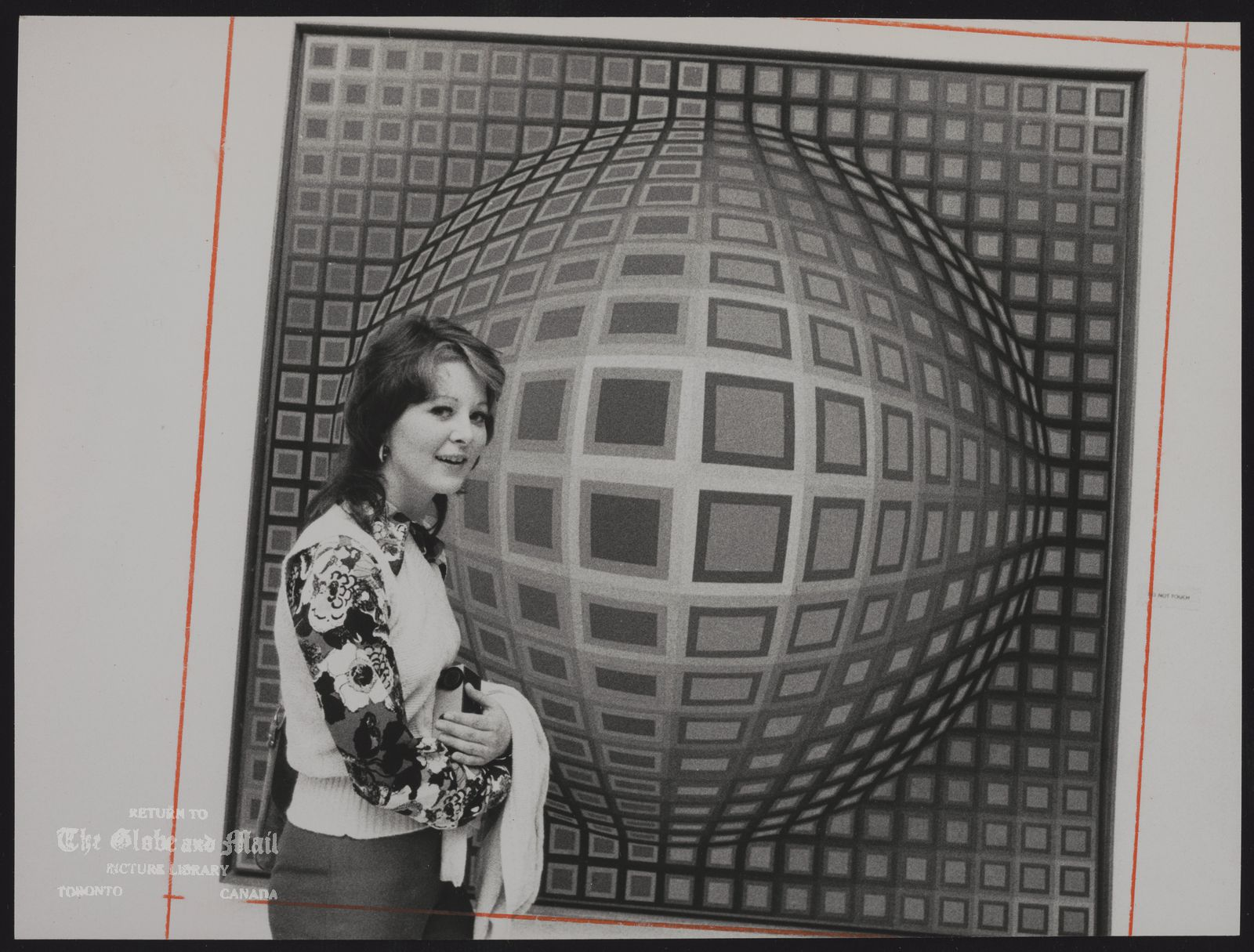 ALBRIGHT-KNOX ART GALLERY (Buffalo, N.Y.) Joanne Frecso of Perth Amboy, N.J., stands by Vega Nor, a 1969 oil on canvas by Victor Vasarely.