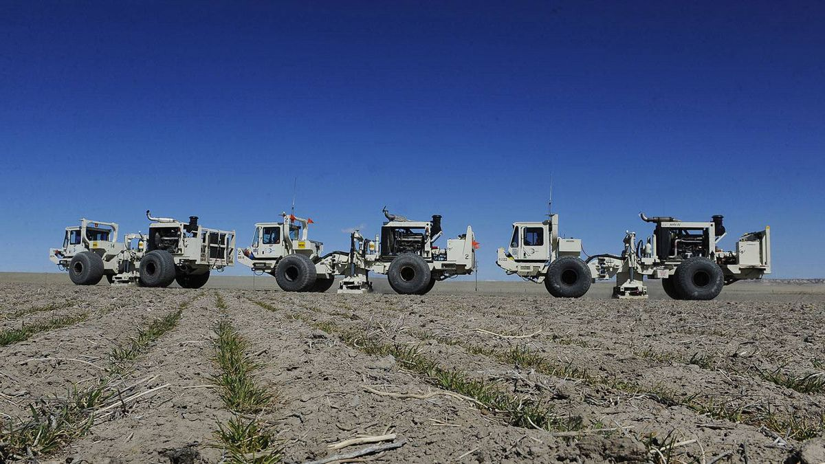 Trucks designed to produce vibrations cross a field during a seismic survey of the Niobrara formation in Colorado.