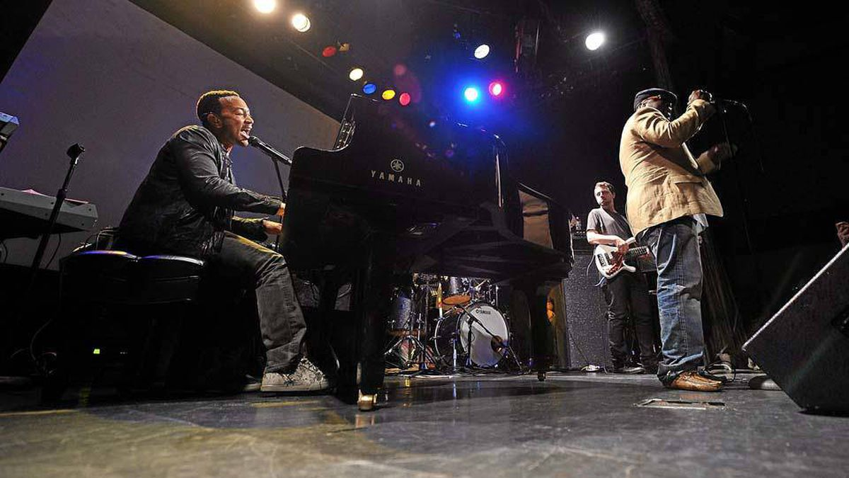 John Legend and members of The Roots perform at the Bowery Ballroom on Aug. 30, 2010 in New York City.