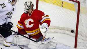 Dallas Stars' Loui Eriksson scores on Calgary Flames goalie Miikka Kiprusoff in Calgary, March 4, 2012.