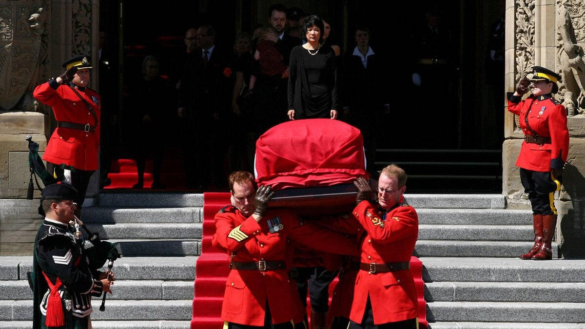 August 25, 2011: NDP MP Olivia Chow and family members watch as the casket of her husband Jack Layton is loaded into a hearse on Parliament Hill in Ottawa.
