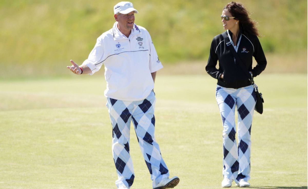Golfer John Daly and his girlfriend Anna Cladakis walk the Old Course, St. Andrews