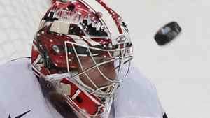 Goalkeeper Jimmy Howard of the U.S. looks at the puck during their 2012 IIHF men's ice hockey World Championship game with Slovakia in Helsinki May 7, 2012. REUTERS/Grigory Dukor