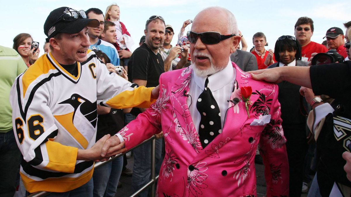 """Don Cherry, announcer on CBC's """"Hockey Night in Canada, """" is greeted by fans as he arrives for Game 2 of the NHL hockey Stanley Cup finals between the Pittsburgh Penguins and the Detroit Red Wings in Detroit, Sunday, May 31, 2009."""