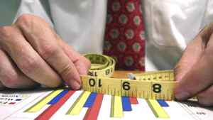 A businessman measuring results.