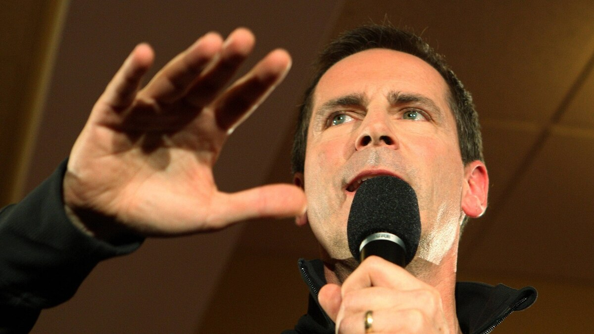 Ontario Premier Dalton McGuinty speaks to the crowd at a campaign rally in London, Ont., Sept. 29, 2011.
