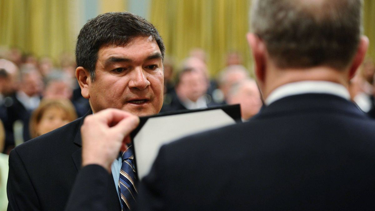 Newly appointed Minister of Intergovernmental Affairs Peter Penashue is sworn in at Rideau Hall in Ottawa on May 18, 2011.