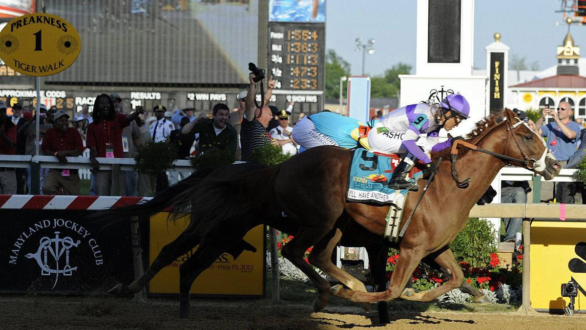 I'll Have Another (9), ridden by Mario Gutierrez, beats Bodemeister, ridden by Mike Smith, to the finish line to win the 137th Preakness Stakes horse race at Pimlico Race Course, Saturday, May 19, 2012, in Baltimore. (AP Photo/Mike Stewart)