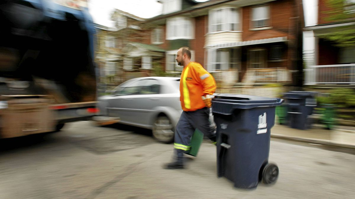Jimmy McIsaac picks up garbage and recyclables on his route on Grace Street, north of Harbord Street, in Toronto. He's worked for the city for 11 seasons, five with the sanitation department.