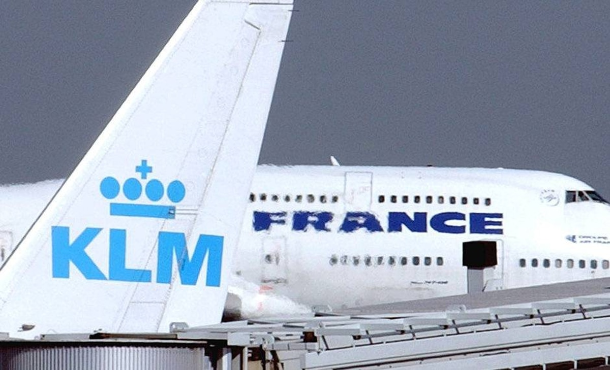 An Air France jumbo jet rolls behind the tail of a KLM Royal Dutch airliner at Charles de Gaulle airport in Roissy, north of Paris.