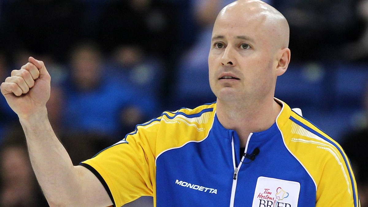 Alberta skip Kevin Koe celebrates his win over Manitoba following an evening semifinal draw at the Tim Hortons Brier in Saskatoon, Sask. Saturday, March, 10, 2012. Alberta will now face Ontario in the gold medal game on Sunday. THE CANADIAN PRESS/Jonathan Hayward