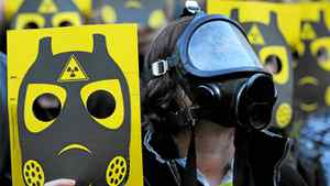 Anti-nuclear activists participate in a demonstration on March 17, 2011 in Sant Jaume square, in Barcelona.