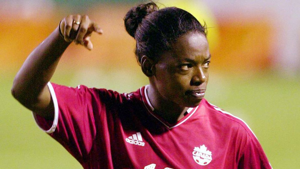 Canada's Charmaine Hooper celebrates as the Canada Women's national soccer team defeats Costa Rica 4-0 for third place in the Olympic Qualifying Tournament for the Confederation of North America, Central America and the Caribbean (CONCACAF) in Heredia, Costa Rica, 20 kilometers north of the capital of San Jose, Friday, March 5, 2004.