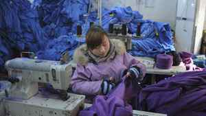 An employee works at a garment factory in Wuhu, Anhui province January 2, 2012.