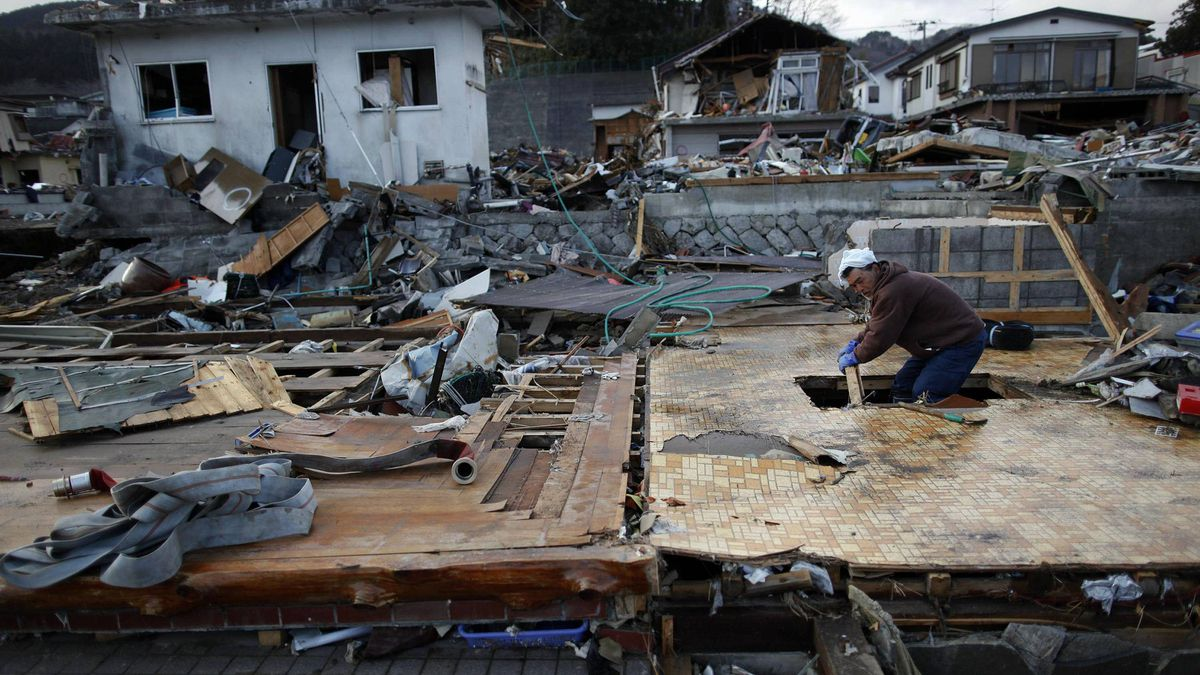 A man searches for belongings at the site where his home once stood in the residential part of Otsuchi after the area was devastated by a magnitude 9.0 earthquake and tsunami March 22, 2011.
