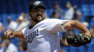 Toronto Blue Jays' pitcher Carlos Villanueva throws against the New York Yankees during the first inning of their MLB American League baseball game in Toronto July 17, 2011. REUTERS/ Mike Cassese