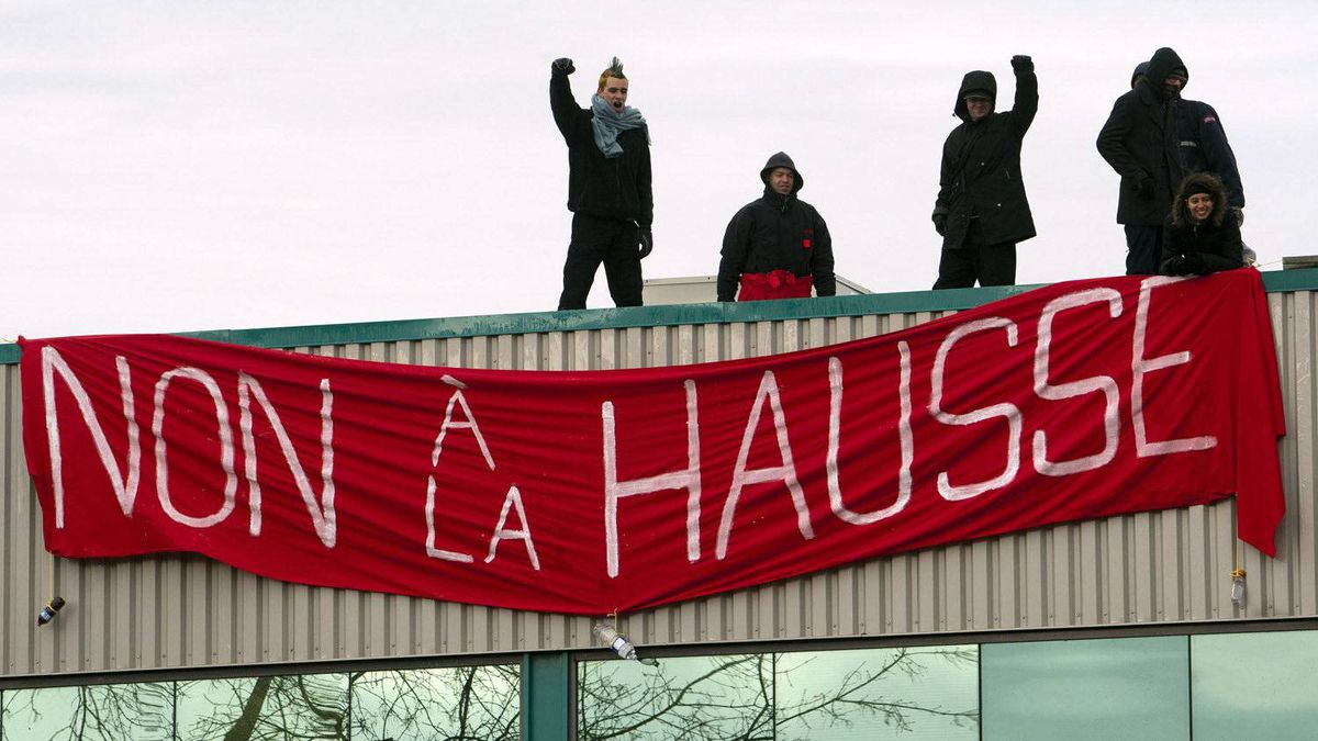 Students hang a banner that reads 'No to the Hike' from the roof of the Quebec Liberal party headquarters as they continue their protest against tuition fee hikes Wednesday, March 28, 2012 in Montreal.
