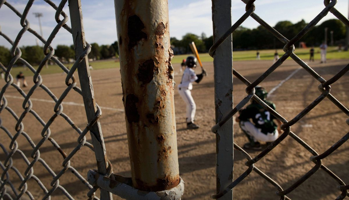 Rust on the fencing on the baseball diamond at Greenwood Park as players from the East York Bulldogs took on the Newmarket Hawks of the Greater Toronto Baseball League