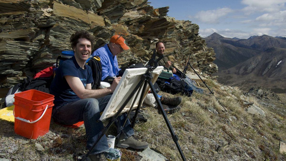 Only 200 people usually visit Ivvavik National Park each summer, many on guided rafting trips that have chartered a plane from Inuvik, NWT, about 250 kms away. Here, painters Greg Hargarten, left, Ken Van Rees and Paul Trottier from Saskatoon draw inspiration from Inspiration Point.