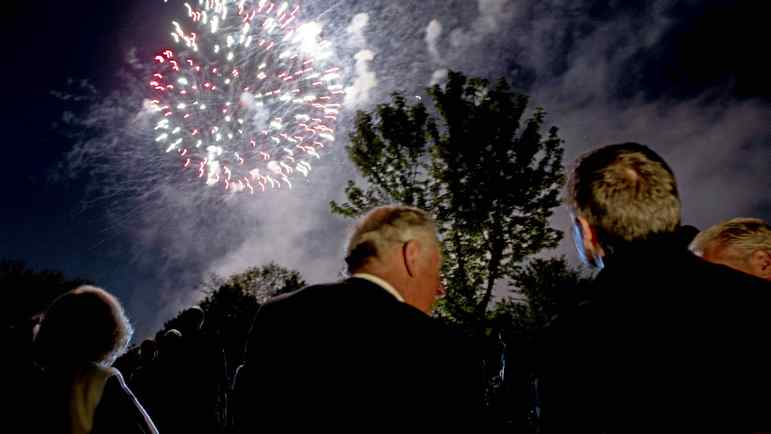 Prince Charles and his wife Camilla watch fireworks with Ontario Premier Dalton McGuinty in Toronto, May 21, 2012.