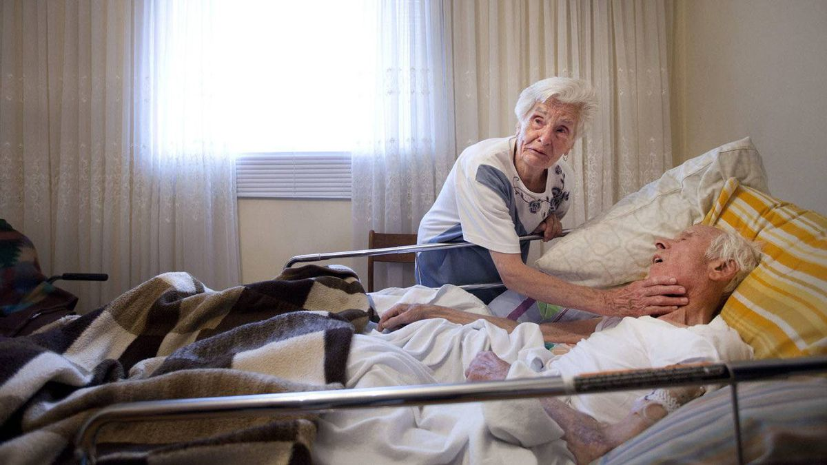 Genia Kuszper at her husband Stefan's bedside in their home July 27, 2011. After efforts to fight his cancer failed his family brought Stefan home for his last days. He died the following morning. Genia and Stefan were married 65 years.