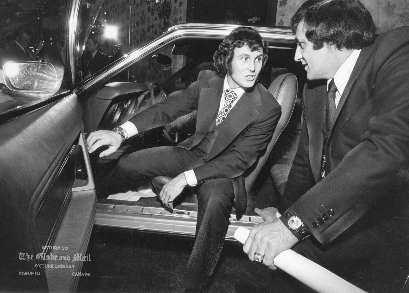 OCTOBER 27, 1972 -- TORONTO -- TEAM CANADA HEROES -- Hero of Game 8 of the Canada-Russia Summit Series, Paul Henderson, left, and teammate, Phil Esposito get sneak preview of cars they won as most popular Team Canada players. Photo by Erik Christensen / The Globe and Mail Originally published October 28, 1972