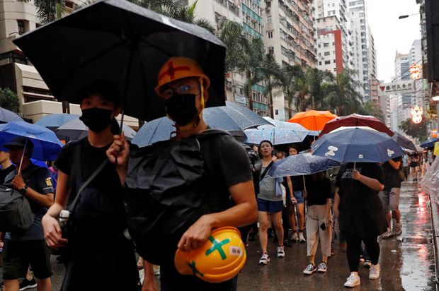 Tens of thousands march in latest Hong Kong protest