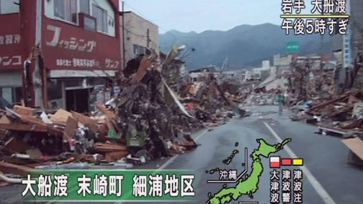 In this image made off Japan's NHK television, debris of houses are left along a street in Ofunato, Iwate Prefecture, northern Japan, Friday, March 11, 2011 after a powerful tsunami spawned by the largest earthquake in Japan's recorded history slammed the eastern coast. Japanese reads: Whole towns of Matsuzaki and Hosoura are swept away in Ofunato
