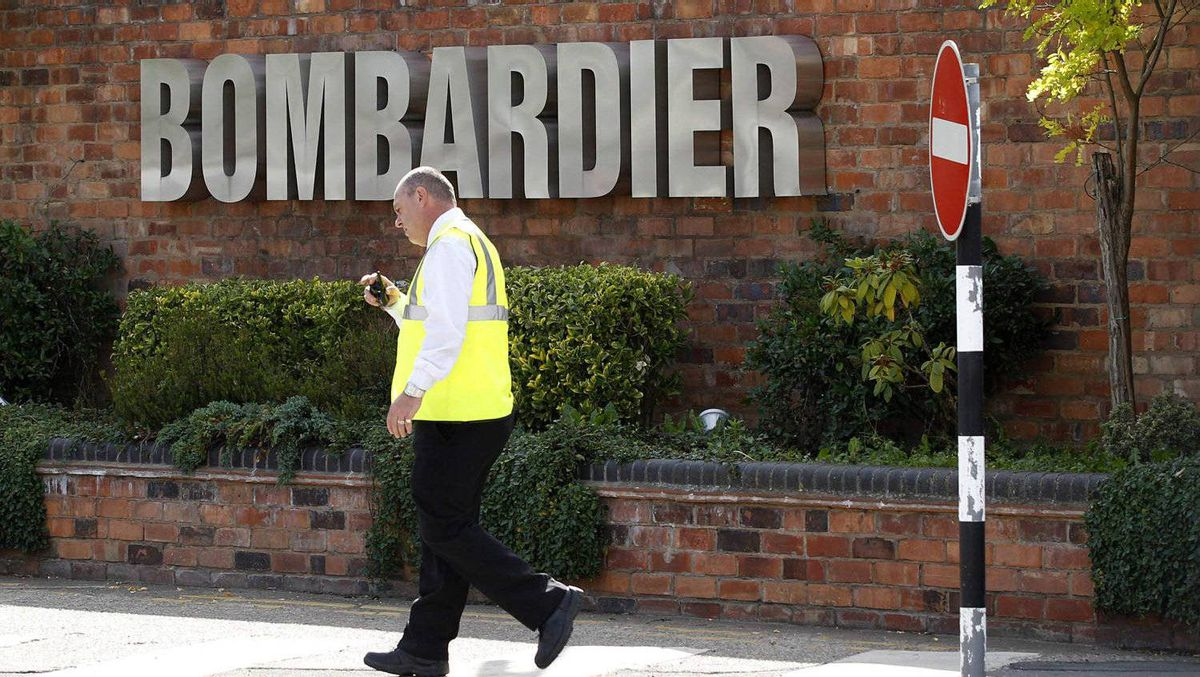 A worker walks past the entrance to the Bombardier plant in Derby, central England, July 5, 2011.