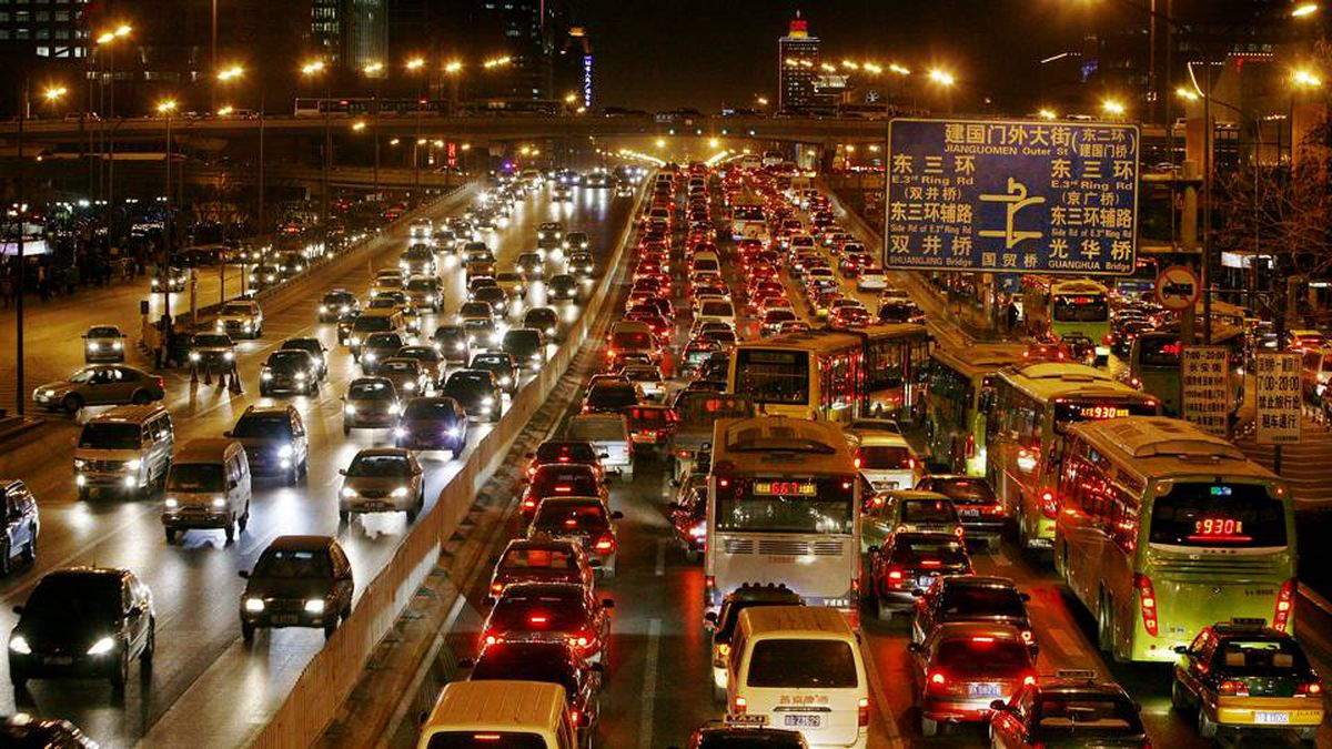 Vehicles are stuck in a traffic jam along a major thoroughfare in the central business district of Beijing
