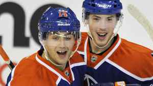 Edmonton Oilers' Jordan Eberle and Ryan Nugent-Hopkins celebrate a goal against the Minnesota Wild during the first period of their NHL hockey game in Edmonton November 30, 2011. REUTERS/Dan Riedlhuber